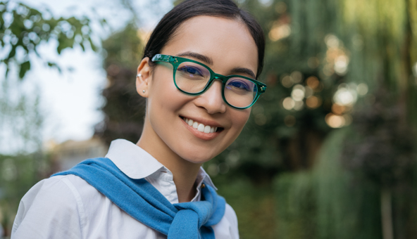 closeup-portrait-smiling-asian-student-wearing-eyeglasses-looking-camera-outdoors-education-concept
